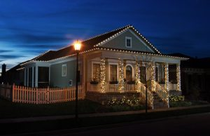 The final product of a custom holiday light install on a single story home.
